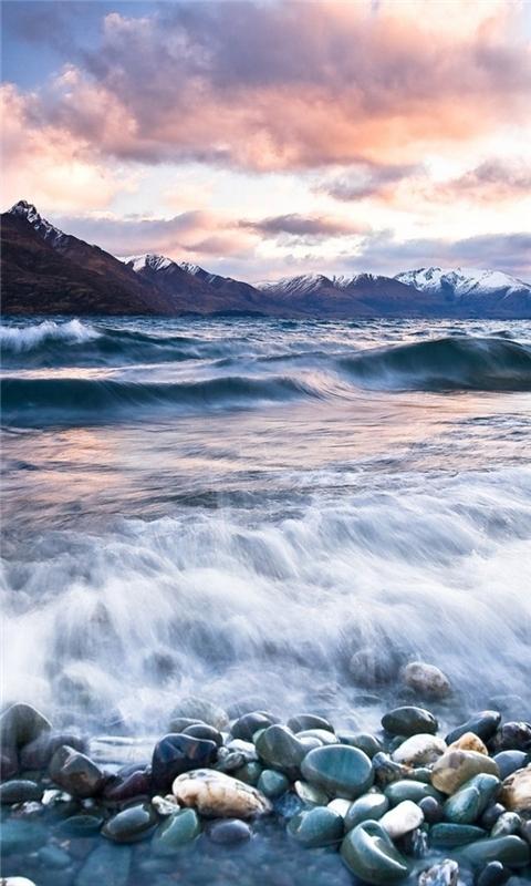 Stones Beach Wave Mountains Clouds Windows Phone Wallpaper