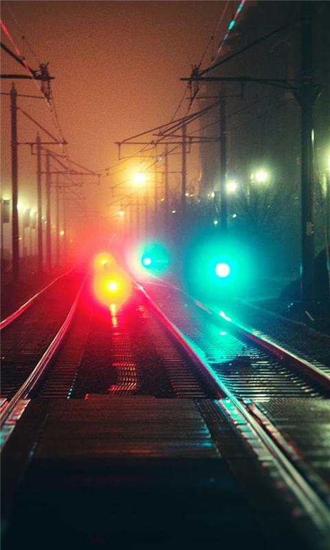 Railroad tracks at night Windows Phone Wallpaper