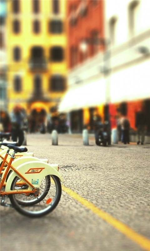 Cityscapes Streets Bicycles Blur Windows Phone Wallpaper