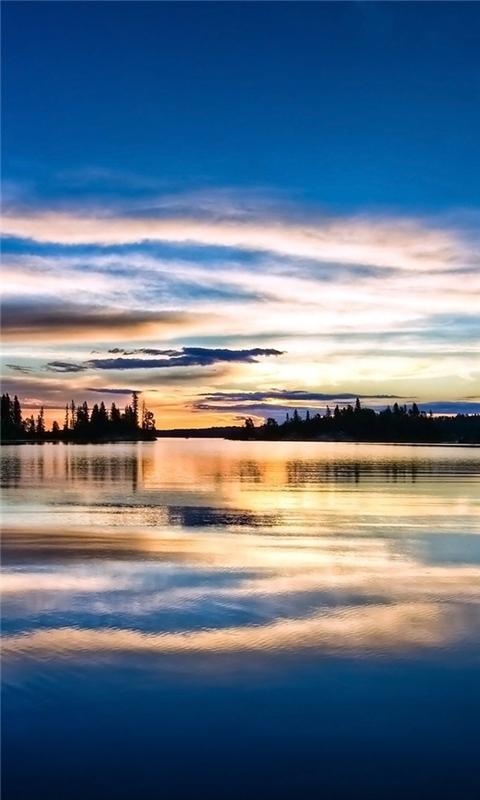 Lake reflecting the evening sky Windows Phone Wallpaper