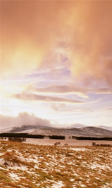 Sunset over frozen field Windows Phone Wallpaper