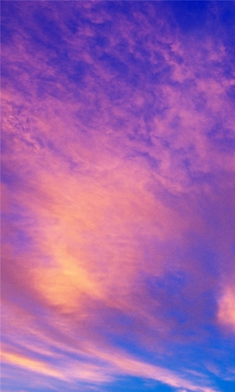 Sunset over clouds Windows Phone Wallpaper