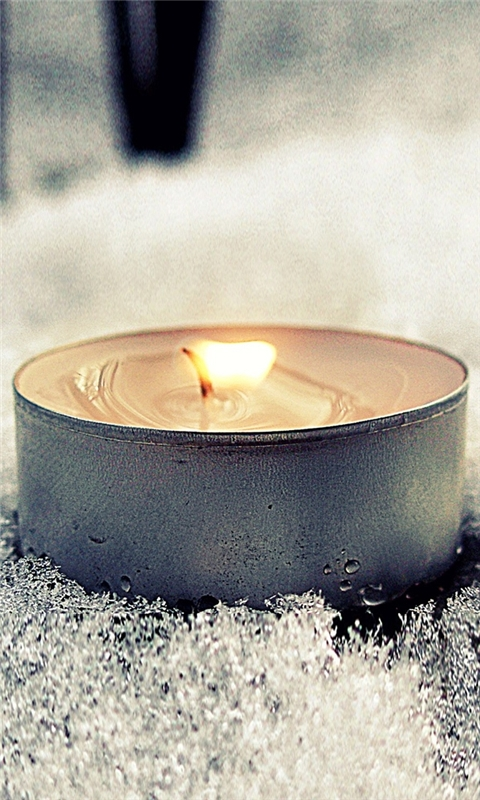 Candle in Snow Windows Phone Wallpaper